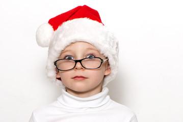 Little Santa Claus on a light background
