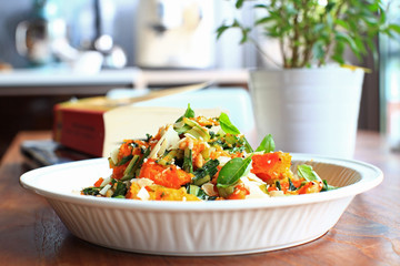 Pumpkin salad with basil, nuts and cheese