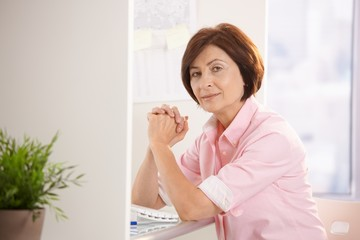 Senior woman sitting at office desk