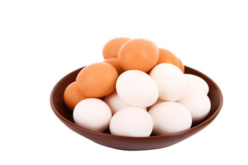 Group of brown and white hen's eggs in the plate isolated on whi