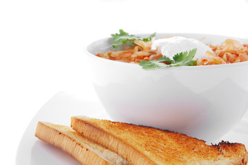 red vegetable soup in white bowl