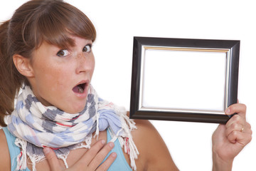 shocked woman with empty photo frame