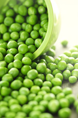 Spilled bowl of green peas