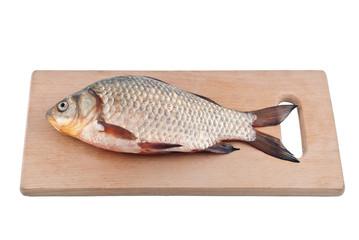 Fish crucian on board.