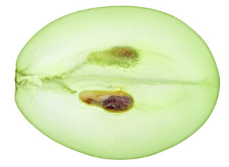 Translucent slice of green grape fruit, macro isolated on white Fototapete