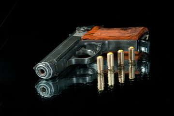 gun with four bullet and water