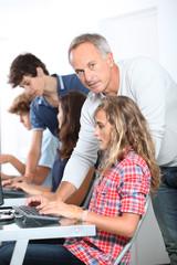 Teenagers in computing class