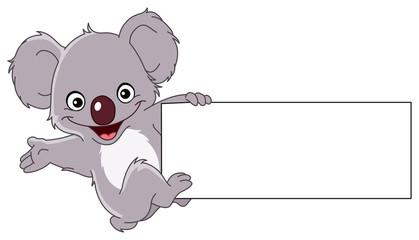 Koala climbing a sign