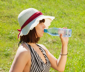girl drinks water from bottle
