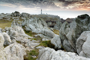 rocky coastline and lighthouse Wall mural