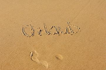 Urlaub in den Sand geschrieben