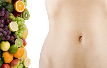 female beautiful body and fresh fruits