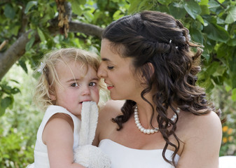 Bride and Young Bridesmaid in the garden on the wedding day