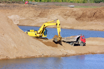 sandpit - excavator and tipper
