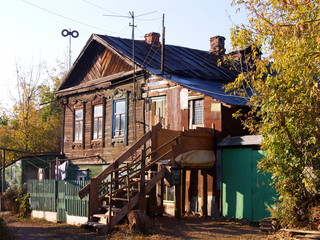 Wall Mural - An old village house against a blue sky in autumn