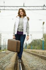 girl  walking along   rail