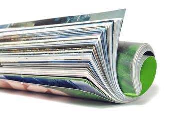 Roll of magazine isolated on white background