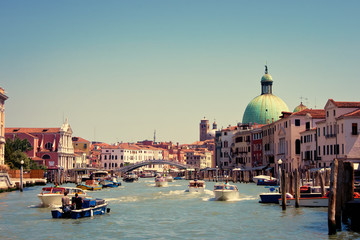 Canal with boats in Venice, Italy.