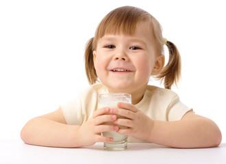 Little girl drinks milk