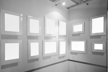 Blank white picture frames in art gallery