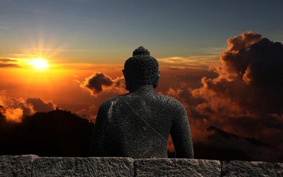 Buddha watching sunset