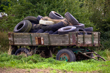 Old wooden wagon fulled with old tyres