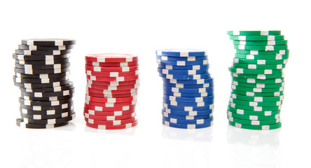 colorful poker casino chips over white background
