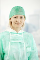 Female medical doctor in scrub suit