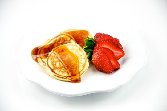 Silver Dollar Pancakes With Strawberry on a White Plate