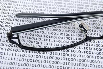 eyeglasses on  binary code