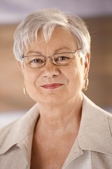 Portrait of senior woman wearing glasses