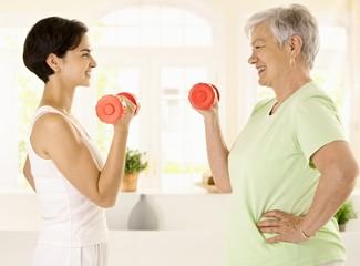 Elderly woman doing dumbbell exercise