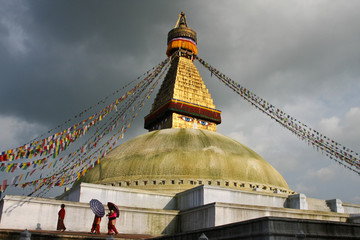 Stupa and people with umbrellas
