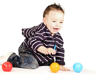 Little boy with group ball