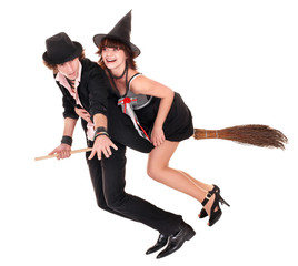 Couple with witch  fly on broom. Isolated.