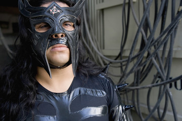 Hispanic man wearing Mexican wrestling costume
