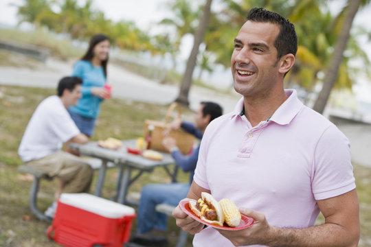 Hispanic friends enjoying barbecue