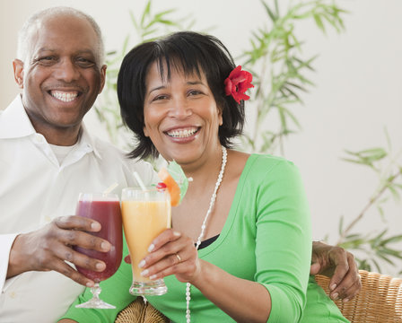 African couple drinking exotic frozen cocktails
