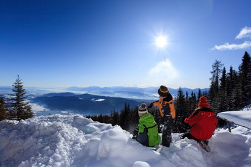 Children in mountain snow