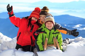 Happy children in snowy Alps
