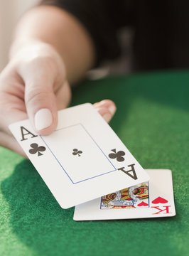 Woman showing black jack hand