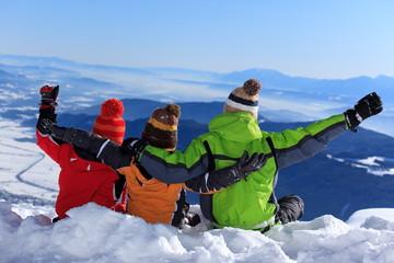 Three kids on a mountain