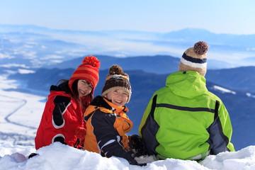 Three children in the snow
