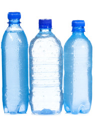 Plastic bottles with water drops