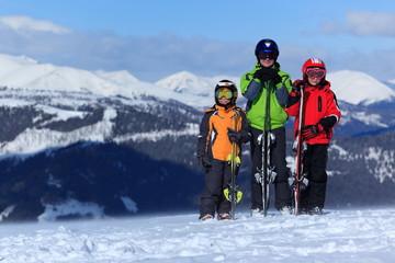 Children with skis on mountain