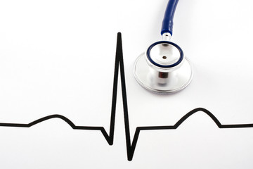 Stethoscope lying on ECG diagram