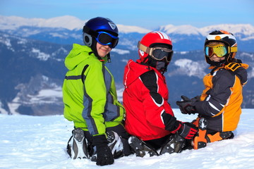 Child skiers on snowy mountain