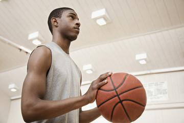 Serious African basketball player preparing to shoot ball