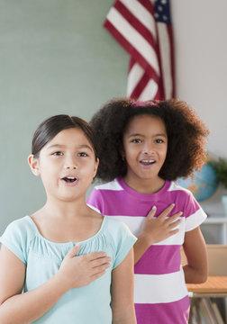 School girls pledging allegiance to the flag