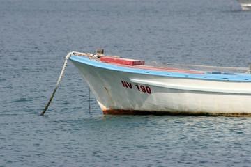 Wooden rowing boat tide down